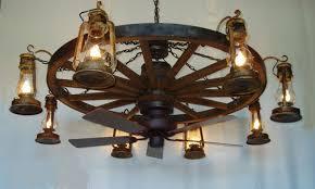 wagon wheel ceiling fan light tier wooden wagon wheel chandelier wlantern lights and ceiling fan