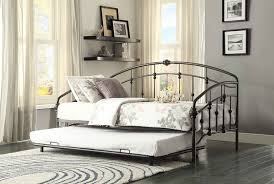 interior natural metal daybed with floral bedding and patterned