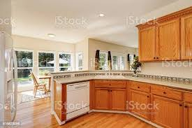 white kitchen countertops with brown cabinets light brown kitchen cabinets and white appliances stock photo image now