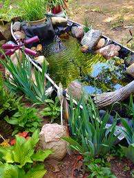 old fishing boat turned into a lovely garden pond stones in the