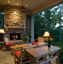 casual den stacked stone fireplace living room rustic with drift