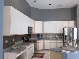 contemporary kitchen with limestone tile floors u0026 built in