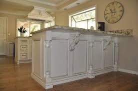 corbels for kitchen island combining two unlikely designs reeded island posts and acanthus