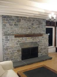 decorations covering brick fireplace with stone veneer home