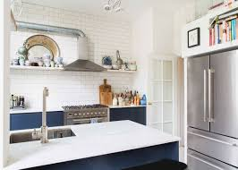 small kitchen with open shelving and dark blue cabinets house