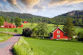 red farm houses in old rural landscape sweden stock photo