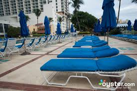 lounge chairs at the outdoor pool at the miami beach resort u0026 spa