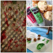 christmas craft for toddlers potato stamped wrapping paper
