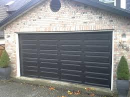 black roller garage door btca info examples doors designs ideas 19203893194928842560 black garage doors with trendy brick house with black garage doors 7e634d black roller
