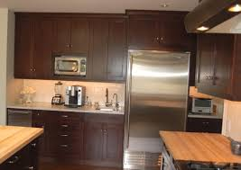 hmm cherry wood cabinets with black appliances and butcherblock