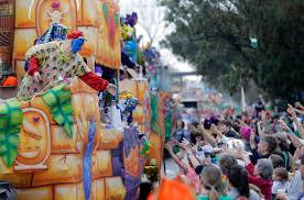 mardi gras trinkets mardi gras parade honors new orleans tricentennial wmya