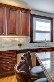 brown kitchen cabinets backsplash ideas cabinets with white granite countertops countertopsnews