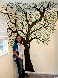 painted tree on a wall custom decor by caitlin veazey
