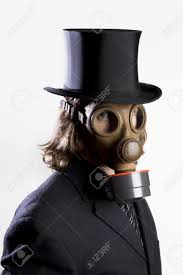 businessman wearing a gas mask and a top hat stock photo picture
