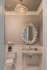 hamptons house half bath featuring robert abbey for the bling