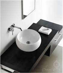 Modern Faucets For Bathroom Sinks by Admirable Design Ideas Using Round Blue Glass Sinks And Cream
