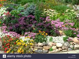 Rock Garden Mn Beautiful Annual And Perennial Flower Garden Lined With A Rock