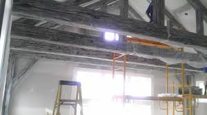 extreme makeover home edition uses faux ceiling beams from
