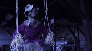 this swinging scarecrow is stuffed with hay and horrors haunted