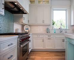 white kitchen cabinets with aqua backsplash coastal white kitchen with turquoise island home bunch