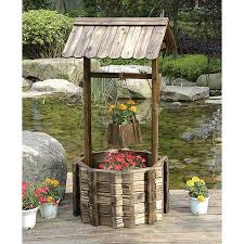 grand wishing well planter inspires grand scale