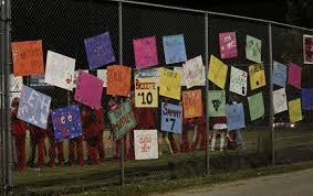 gallery crimson field hockey wins against north oldham manual the underclassmen field hockey players make signs in support of their seniors