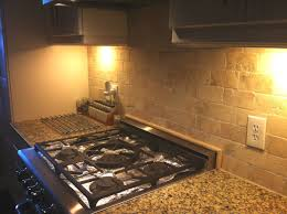 traditional kitchen backsplash images white cabinets cream granite