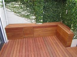 exterior small balcony deck with full wood furniture and floor