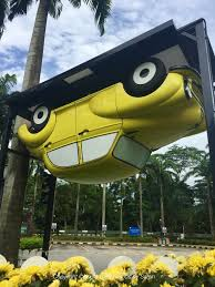 kuala lumpur s upside down house is here kualalumpurkids the entrance to the upside down house is this rather attractive car