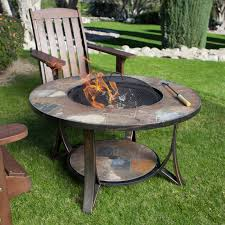exterior round costco fire pit with dark adirondack chair on