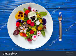 edible blue flowers edible flowers salad plate on blue stock photo 617181503