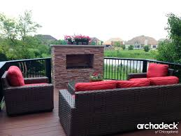 outdoor fireplace on timbertech deck by chicago deck builder archadeck of chicagoland