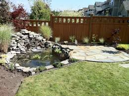 backyard ponds made from natural stone river rock landscape