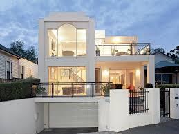 glass modern house exterior with balcony u0026 hedging house facade