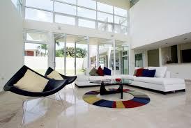 living room white sofa brown cushions gray rug white tile