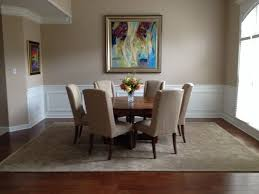 traditional dining room with hardwood floors by pamela boyd
