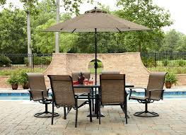 Patio Sets With Umbrellas by Patio Furniture Patio Dining Set With Umbrella And Green Cushion