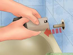how to change a bathtub faucet 2 easy ways to change a bathtub faucet with pictures