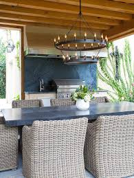 Dining Table With Rattan Chairs Zinc Outdoor Dining Table With Wicker Dining Chairs Transitional