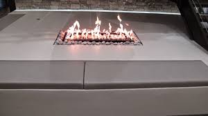 contemporary 4 sided gas fireplace with stainless steel finish