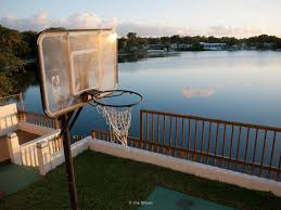 ira block photography a basketball hoop at a backyard next to a