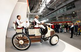 porsche stuttgart factory porsche factory drivers thrill fans with 1st hybrid before start