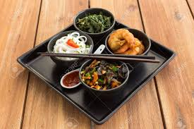 traditional japanese dinner table traditional japanese dish on a square plate in black bowls with