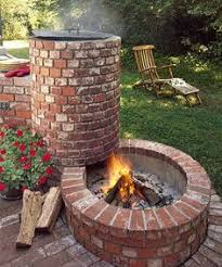 Old Fire Pit - fire pit with openings at the bottom for airflow and keep feet