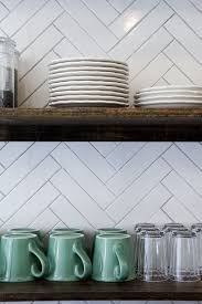 picture backsplash kitchen kitchen backsplashes dazzle with their herringbone designs