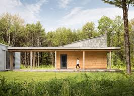 how to go about building a house go logic builds a wooden house in a forest clearing in maine