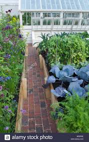beautiful vegetable garden with raised beds brick path modern
