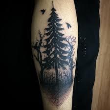 black ink pine tree on back leg