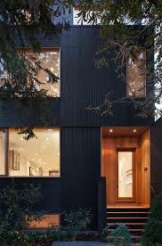 douglas fir cladding around door of toronto renovation by modern