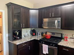 brown kitchen cabinets with backsplash what color should i paint my kitchen cabinets textbook